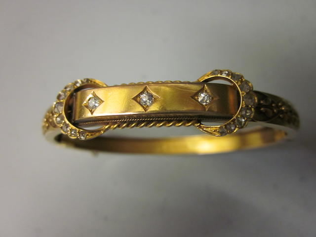 A 15ct gold diamond set bangle,