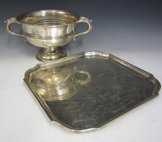 A silver two handled pedestal presentation trophy cup by Walker and Hall,  Sheffield 1930  (2)