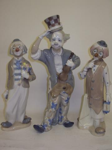 A Lladro clown figure, and two other clown figurines