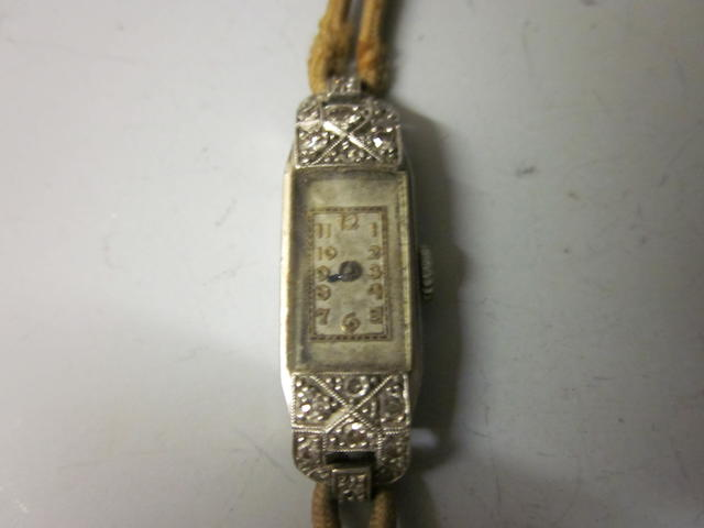 A lady's platinum and diamond set strap watch,