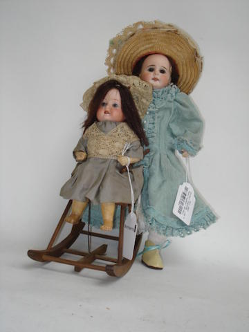 Heubach Koppelsdorf 320 bisque head mechanical doll in rocking chair 2