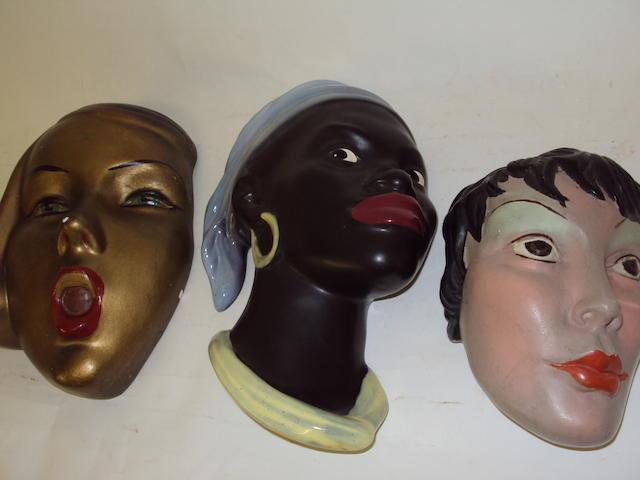 Three ceramic wall masks