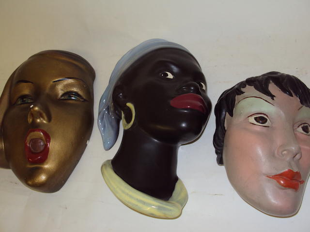 Three ceramic wall masks