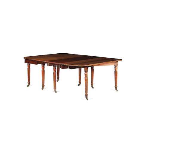 A George IV mahogany concertina action dining table
