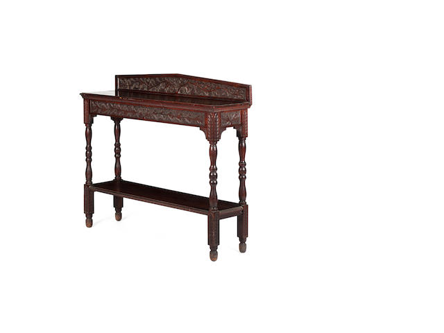 A suite of early 20th century carved oak hall furniture