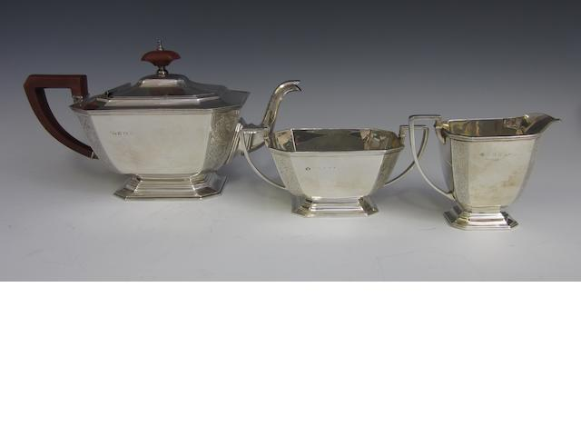An Art Deco silver three piece tea service by Adie Brothers, Birmingham 1947