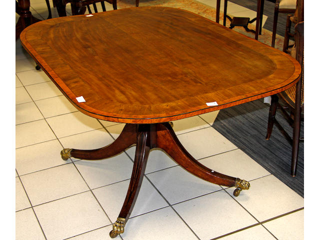 A George III mahogany and satinwood crossbanded breakfast table