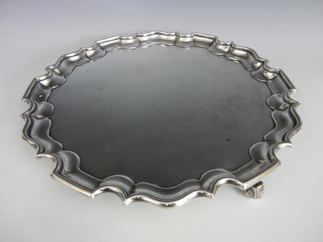 An Edwardian circular silver salver by Thomas Bradbury, London 1904