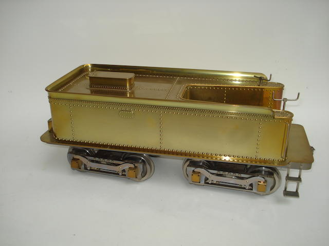 A well engineered scratch built brass model of a 3 1/2in gauge double bogie tender