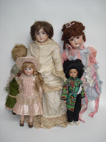 Five reproduction dolls 5