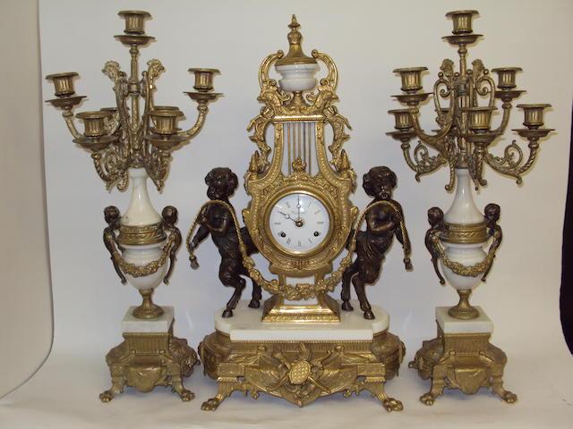 A reproduction gilt metal mantel clock garniture