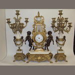 A reproduction gilt metal mantel clock garniture