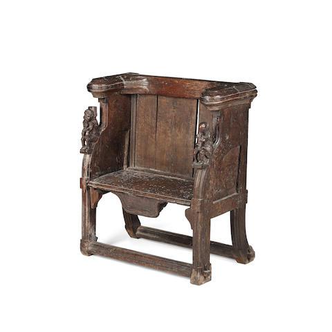 A rare late medieval oak misericord chair  pre 1540