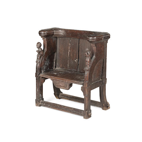 A rare late medieval oak misericord chair, pre 1540