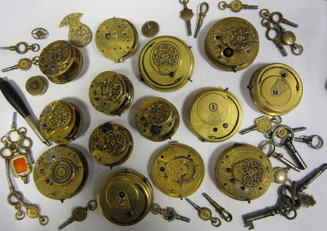 A lot of 14 various pocket watch movements and a selection of keys