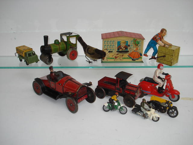 A Hess tinplate open tourer and other toys lot