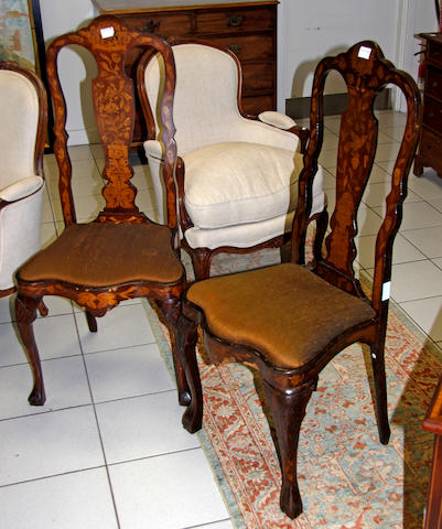 A set of four early 19th century Dutch oak and walnut marquetry inlaid chairs