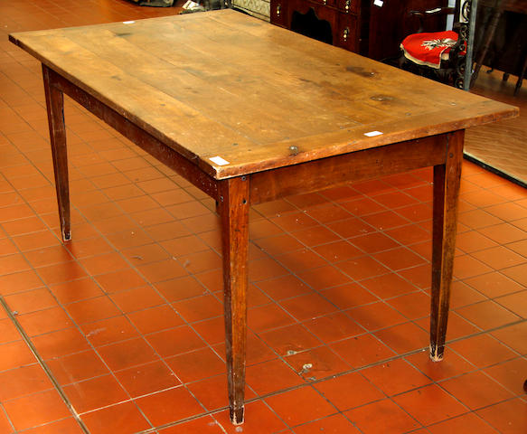 A French provincial pearwood dining table,
