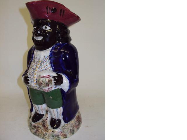 A Staffordshire Toby jug, late 19th/ early 20th century