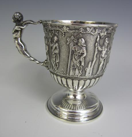 A Victorian silver pedestal christening mug by Houle and Houle, London 1877