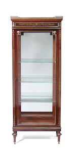 A French Directoire style mahogany and brass inlaid display cabinet