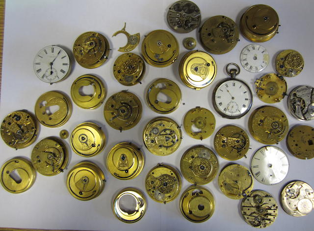 A lot of various pocket watch movements, spare glass and parts