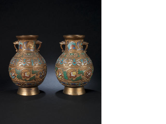 A pair of champslevé vases