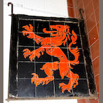 A ceramic red lion pub sign and wrought iron bracket