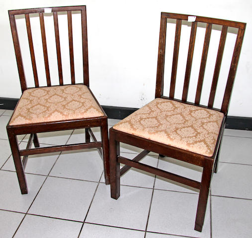 A pair of George III mahogany dining chairs,with pierced splats, drop-in seats and square legs and a set of six oak dining chairs with slatted backs, drop-in seats and square frames