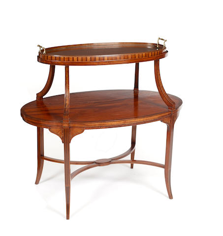 An Edwardian mahogany two tier oval occasional table