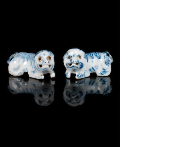 A pair of blue and white, porcelain Buddhistic Lions