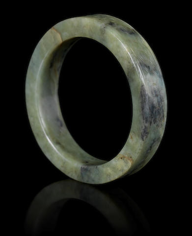 A spinach-green jade bangle