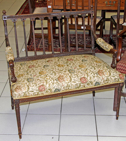 An Edwardian stained beech two seater settee
