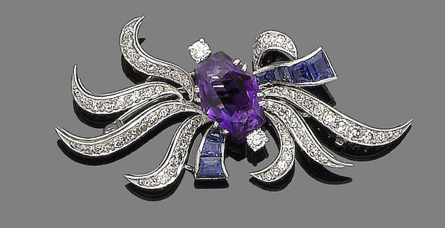 An amethyst, sapphire and diamond spray brooch