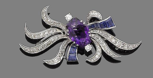 An amethyst, sapphire and diamond spray brooch