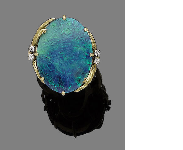 A gold, black opal and diamond ring,