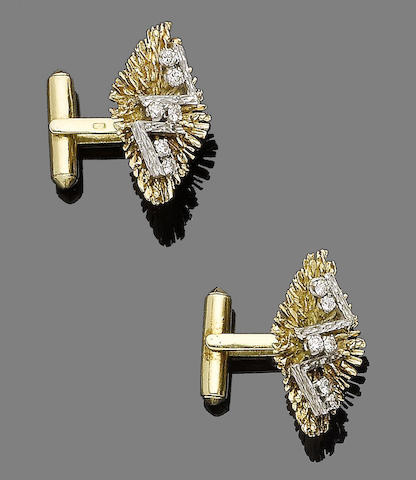 A pair of diamond cufflinks,
