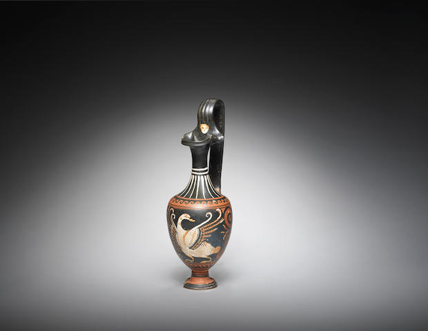 A South Italian pottery oinochoe with a swan