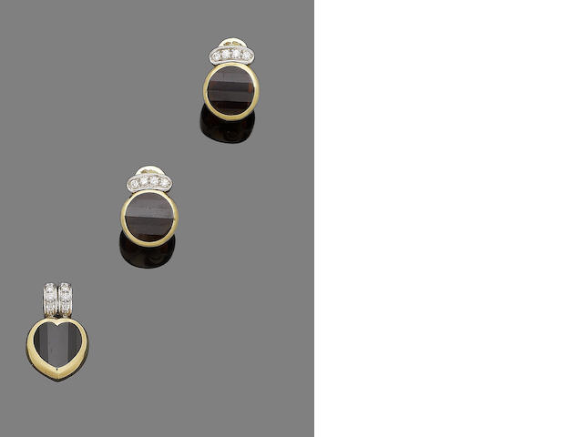 A pair of garnet and diamond earclips and pendant suite, by Pomellato (2)
