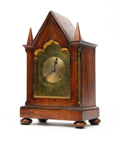 A fine English mid 19th century rosewood 'steeple' mantel clock  Anonymous