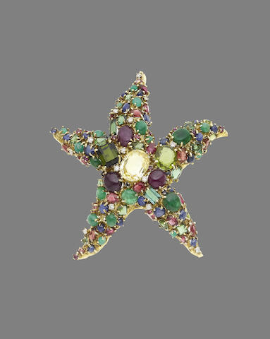 A gem-set brooch (illustrated above)