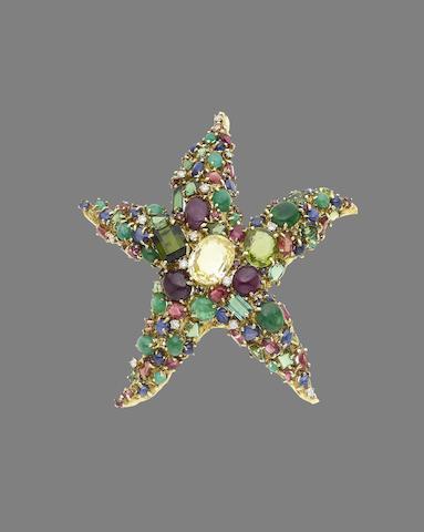 A gem-set brooch (illustrated above)