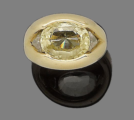 A yellow sapphire and diamond ring, by Bulgari
