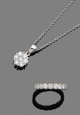 A diamond eternity ring and a diamond pendant necklace (2)
