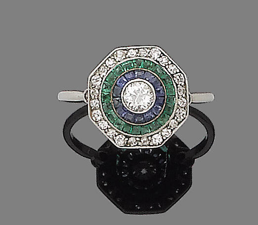 An art deco emerald, sapphire, synthetic sapphire and diamond target ring,