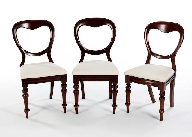 A matched set of eleven Victorian mahogany balloon-back dining chairs