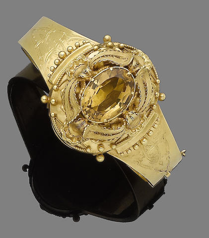 A citrine and gold bangle,