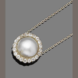 A cultured blister pearl and diamond pendant necklace