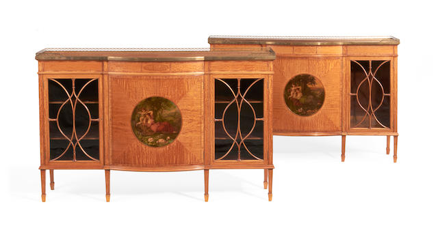 A pair of Edwardian satinwood, tulipwood crossbanded and polychrome decorated side cabinets by Waring & Gillow, in the Sheraton revival style