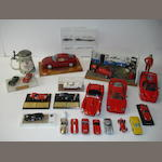 A detailed garage diorama with Alfa Romeo and a collection of Ferrari models,